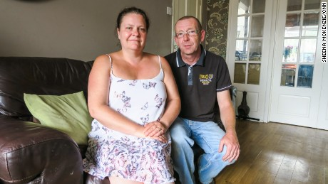 """""""We've been through worse storms than this,"""" said Tony Bush, pictured with wife Emma Hamblett."""