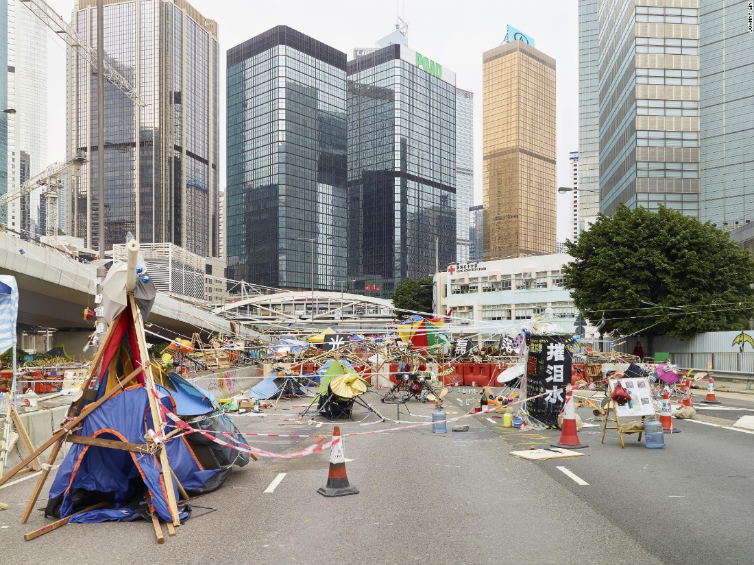 """When Hong Kong's massive Occupy protests took over city streets in 2014, Hong Kong photographer Johnny Gin began creating images of demonstrators' homemade barricades as a """"vernacular expression of protest culture."""" For Gin, the structures showed """"how adaptive Hong Kong people are, in terms of making the best out of a very bad situation."""""""