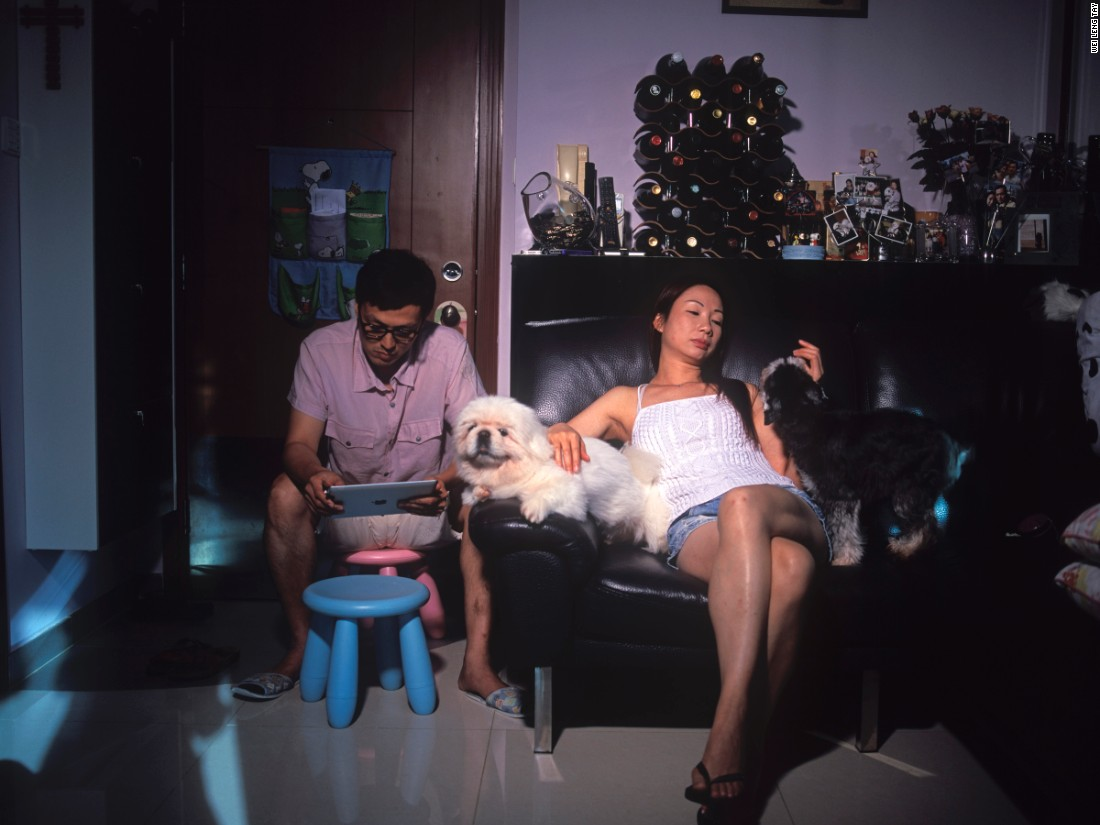 """Singapore-based photographer Wei Leng Tay created pictures of Hong Kongers inside their homes to """"reach out and see what other people were doing with their lives, and how they were handling the spaces and stresses of living in Hong Kong,"""" she says. """"The work helps me make sense of... our personal lives and the multiple roles we play."""""""