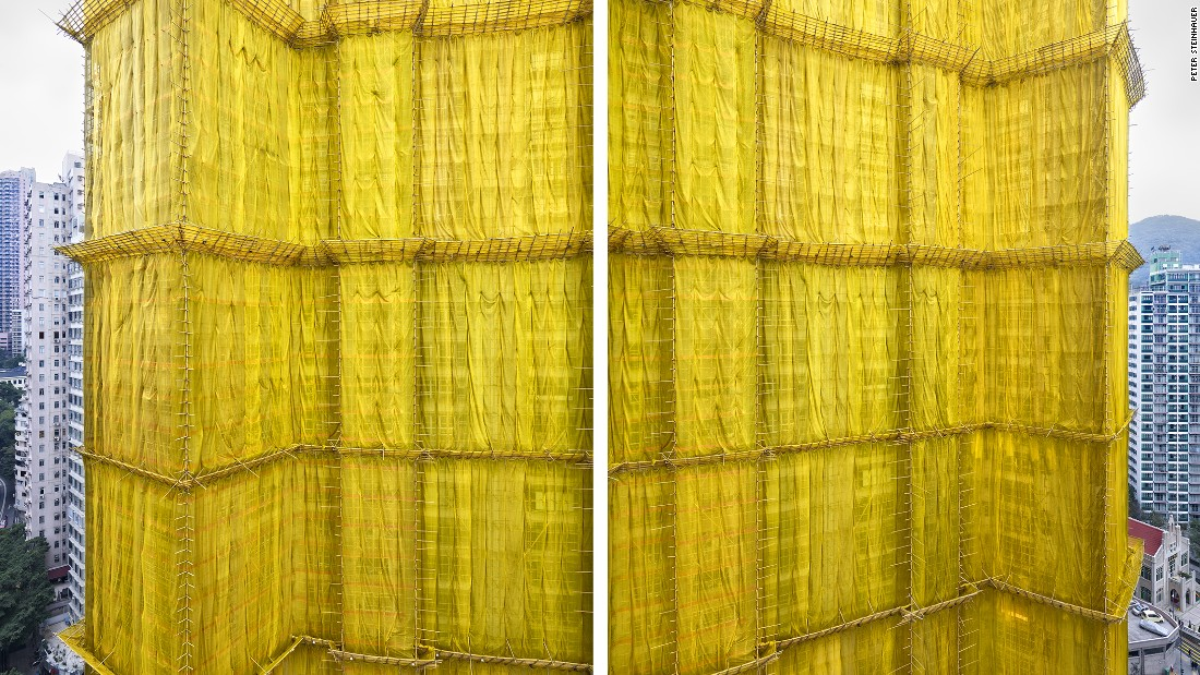 """U.S.-based photographer Peter Steinhauer was awestruck by Hong Kong's building """"cocoons,"""" referring to the colorful exterior wrappings used in renovation work for the city's high-rise structures."""