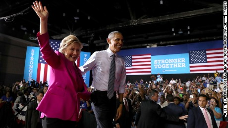 CHARLOTTE, NC - JULY 05:  Democratic presidential candidate former Secretary of State Hillary Clinton (L) and U.S. president Barack Obama greet supporters during a campaign rally on July 5, 2016 in Charlotte, North Carolina. Hillary Clinton is campaigning with president Obama in North Carolina.  (Photo by Justin Sullivan/Getty Images)