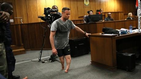 Oscar Pistorius walks on stumps in court