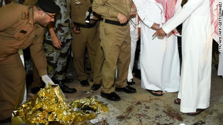 Saudi Emir of Medina Faisal bin Salman bin Abdulaziz (2R) and security officers look at blood stains on the ground after a suicide attack near the security headquarters outside one of Islam's holiest sites, the Prophet's Mosque in Medina on July 4, 2016. Four Saudi security personnel were killed and five others were wounded in the suicide bombing that took place as Muslim worshippers were gathering at the mosque for the sunset prayers, which mark the time when they could break their fast during the holy month of Ramadan, which ends on July 5.   / AFP / STR        (Photo credit should read STR/AFP/Getty Images)