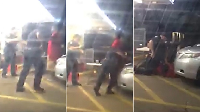 Video of officers shooting man pinned down sparks outrage