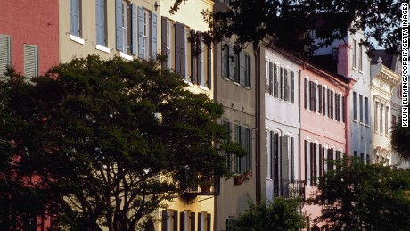 Row houses along Charleston's Battery Street are each painted a different color giving the area the nickname of Rainbow Row. Charleston, South Carolina, USA.