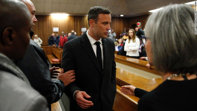 South African Paralympian athlete Oscar Pistorius speaks with relatives as he leaves the High Court in Pretoria, on Wednesday, July 6, after being sentenced to six years in jail for murdering his girlfriend Reeva Steenkamp three years ago. Pistorius was freed from prison in the South African capital Pretoria last October after serving one year of a five-year term for culpable homicide, the equivalent of manslaughter.