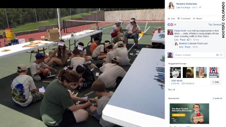 A picture on Hooters Colorado's Facebook page shows Hooters girls working with the Scouts.