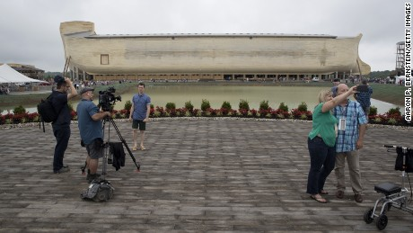 Members of the media and patrons film themselves at the Ark Encounter on July 5 in Williamstown, Kentucky. The Ark Encounter is a theme park centered around a modern interpretation of Noah's Ark. According the parks website the Ark is the largest timber framed structure in the world. It is seven stories tall and 510 feet long.