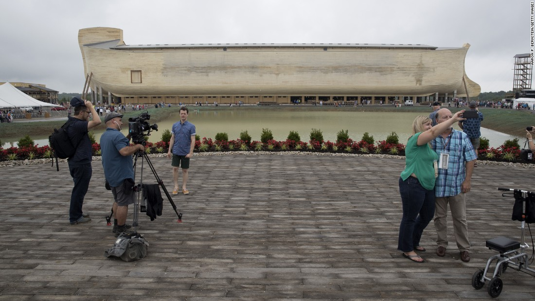 """People film themselves at the <a href=""""https://arkencounter.com"""" target=""""_blank"""">Ark Encounter,</a> a theme park in Williamstown, Kentucky, on Tuesday, July 5. The park, with its modern interpretation of Noah's Ark, opens to the public on Thursday, July 7."""
