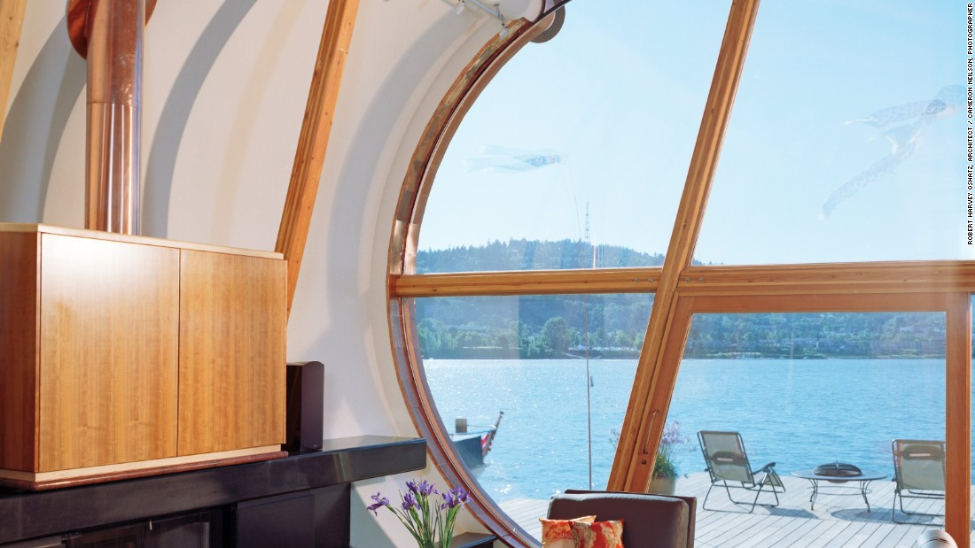 Surprisingly spacious inside, the 2,153-square-foot (200sqm) houseboat includes a loft-style master bedroom and an open living space. Drawn up like a sail, a clean white wall draws focus to the piece de resistance: a floor-to-ceiling glass window that looks onto the river.
