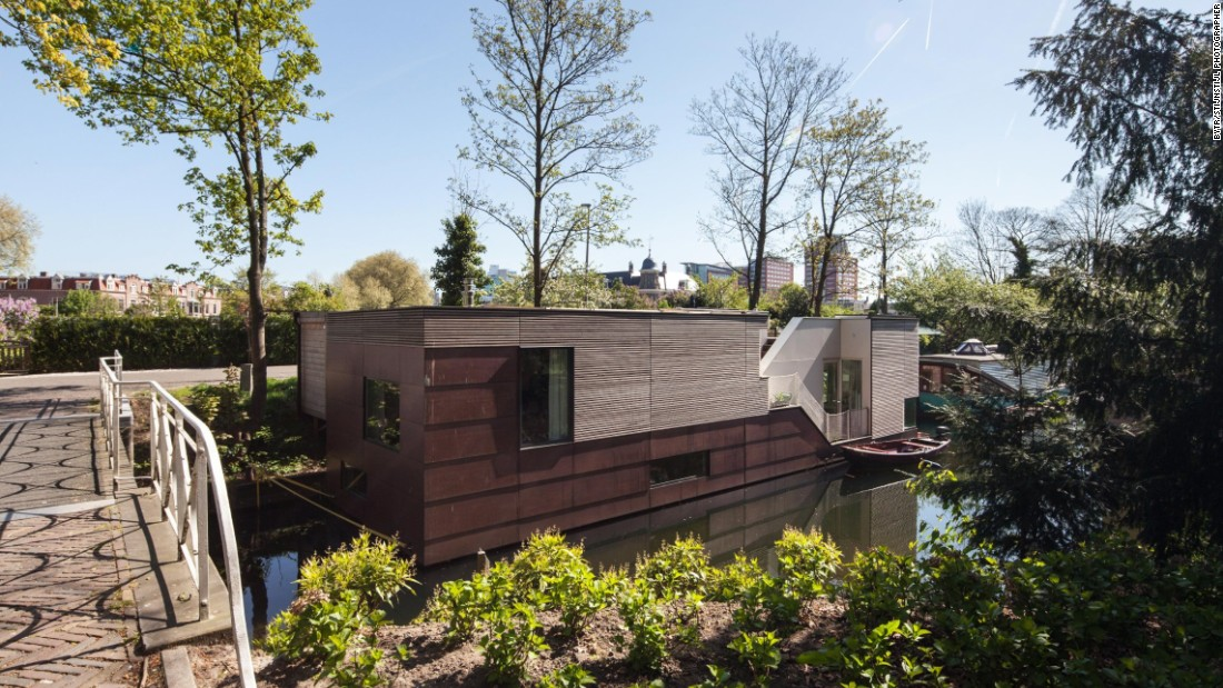 You won't find any portholes aboard The ParkArk Oog-in-Al, but the contemporary houseboat still floods with natural light from enormous windows and skylights. Another custom project from BYTR architects, the copper-clad boat is moored on a leafy green canal in Utrecht right next to a footbridge. Due to its public location, the designers strategically planned the home's doors and windows to enable park and river views while maintaining a sense of privacy.
