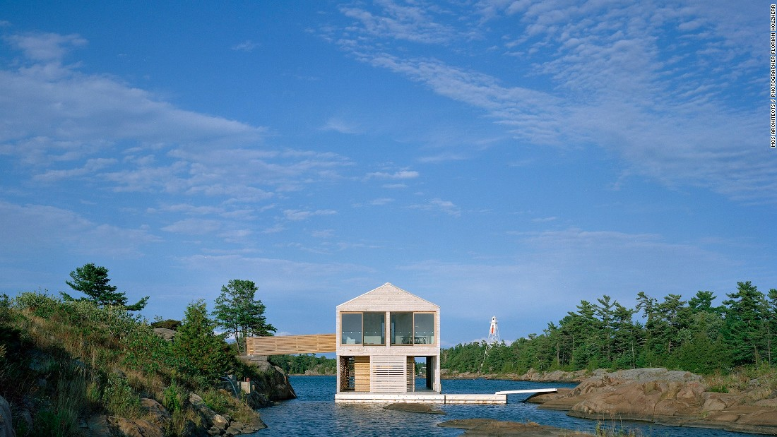 Inspired by the surroundings, MOS Architects designed Floating House Lake Huron with clean lines and a natural palette. Inside, bright white walls and enormous windows open up the ground floor's 1,000-square-foot space (92 square meters), while cedar rain screens on the facade offer both form and function.