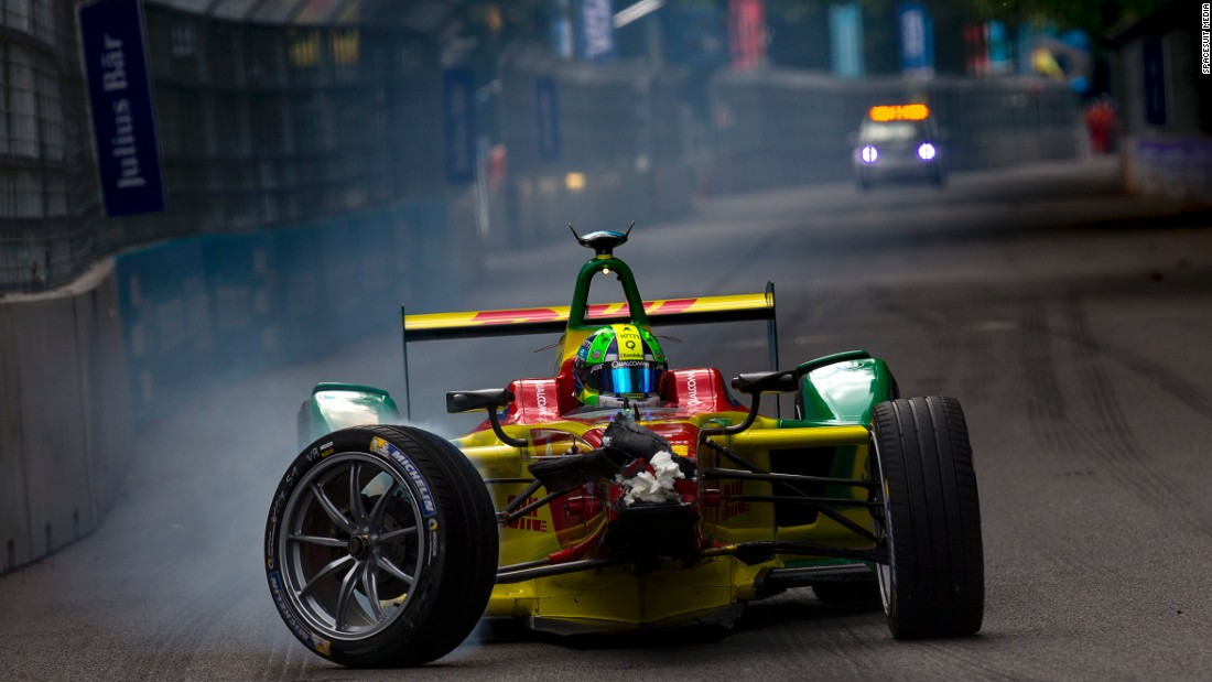 Lucas di Grassi limps back to the pit lane after crashing into the back of Sebastien Buemi in Sunday's final race. The Brazilian ended up two points behind eventual championship winner Buemi.