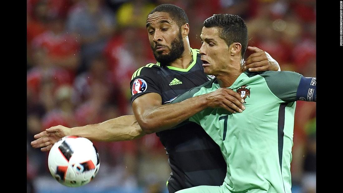 Welsh defender Ashley Williams fights off Ronaldo.