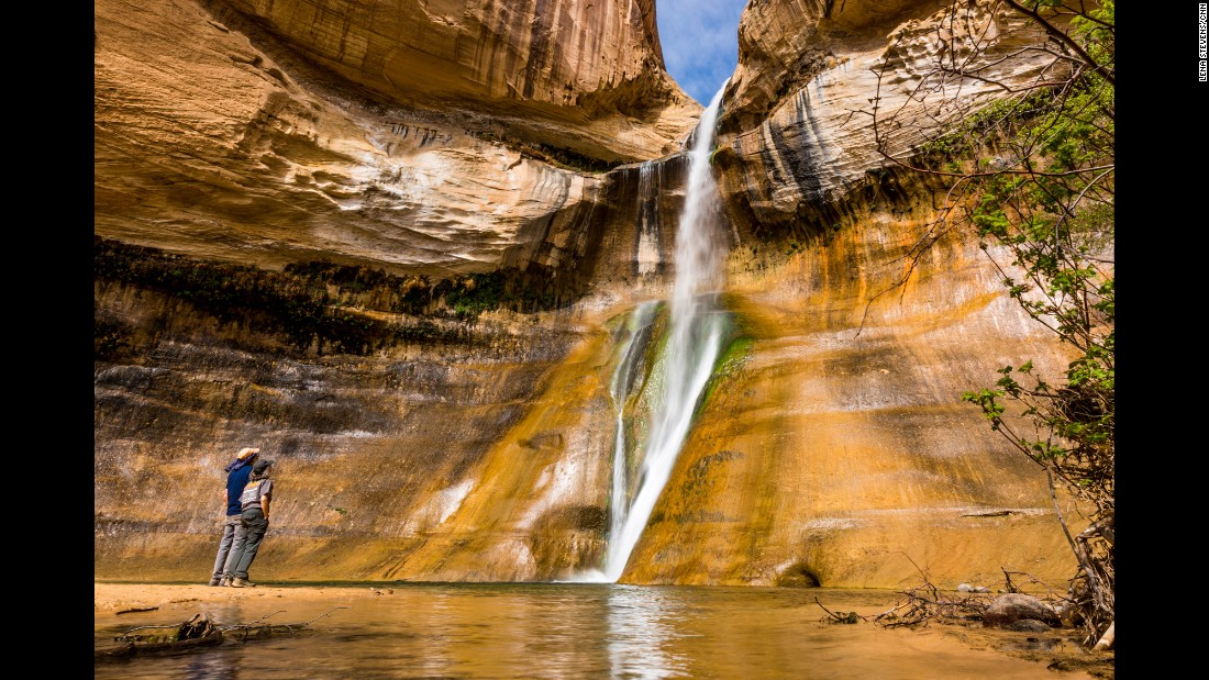 While not in a national park, Calf Creek Falls are about 16 miles east of Escalante, Utah, and about an hour south of Capitol Reef National Park. The six-mile Lower Calf Creek Falls hike is about a three-hour round trip if you spend some time at the waterfall and walk at a comfortable pace.
