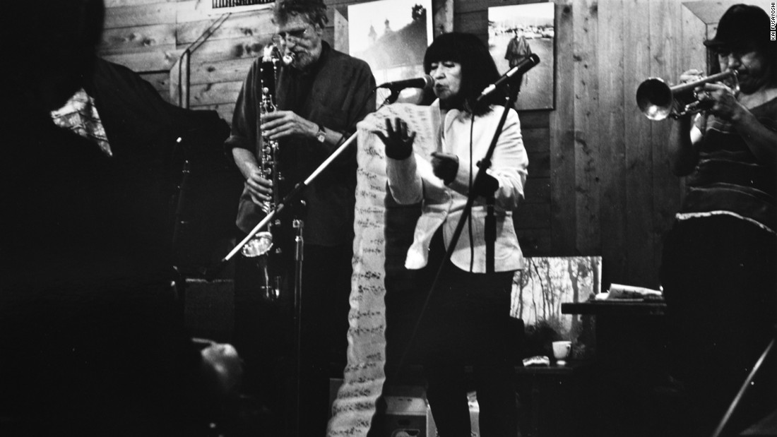 Japanese street photographer Kai Fusayoshi co-founded Café Honyarado, a hub for Kyoto's counterculture, artistic and activist scene. Here, Kazuko Shiraishi, a controversial Japanese poet who read her work alongside live jazz performances by the likes of John Coltrane, performs.