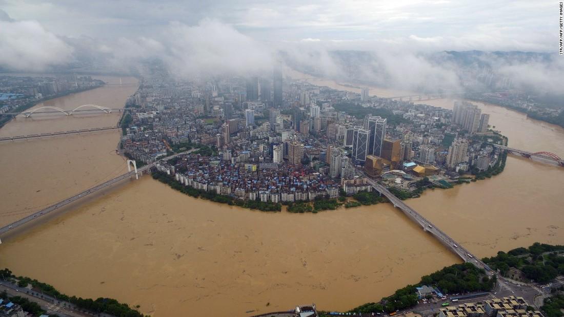 The city of Liuzhou, Guangxi province is surrounded by the swollen Liujiang River July 5.