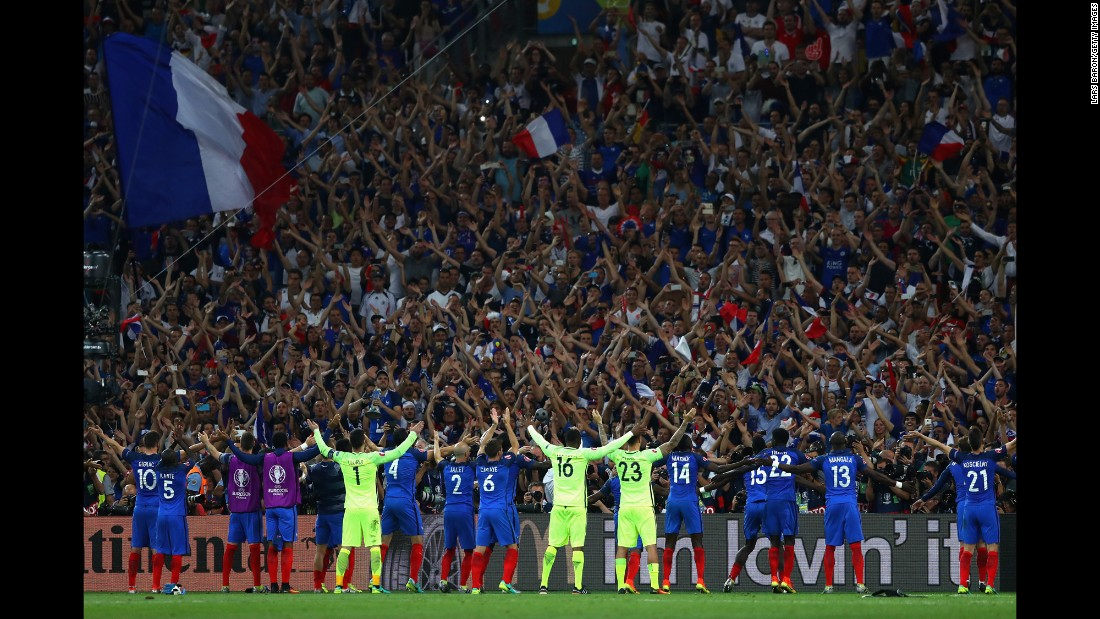 French players celebrate with fans.