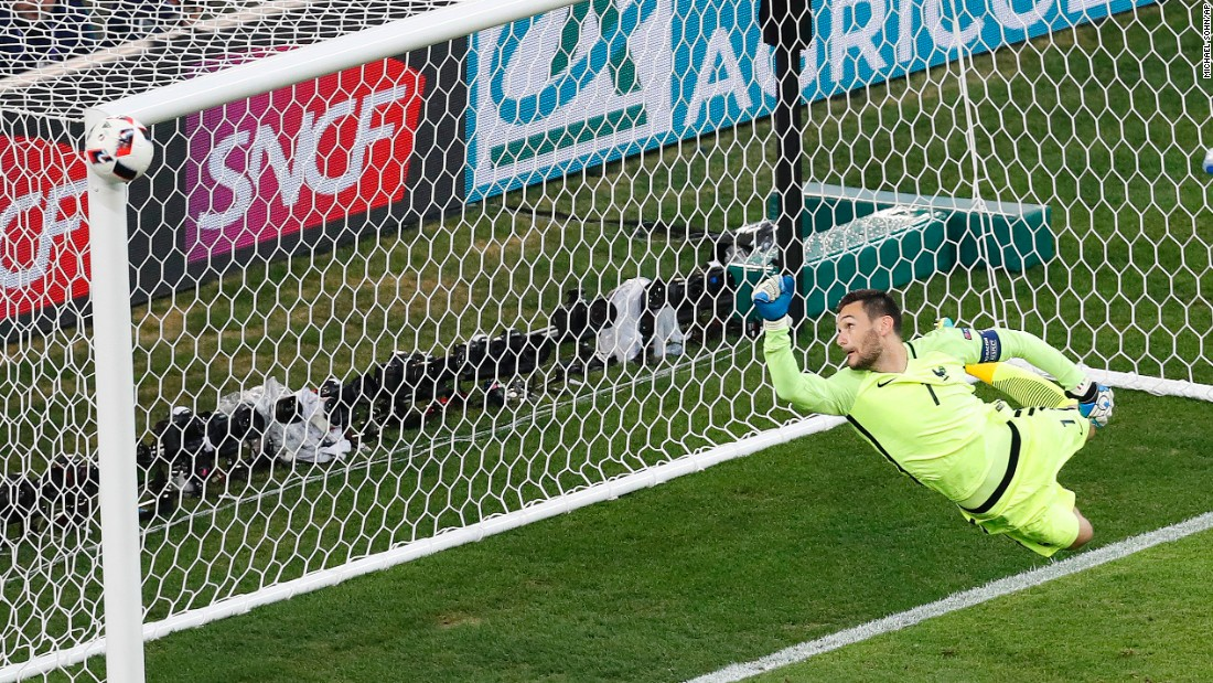 French goalkeeper Hugo Lloris watches as a shot from Germany's Joshua Kimmich hits the post late in the second half.