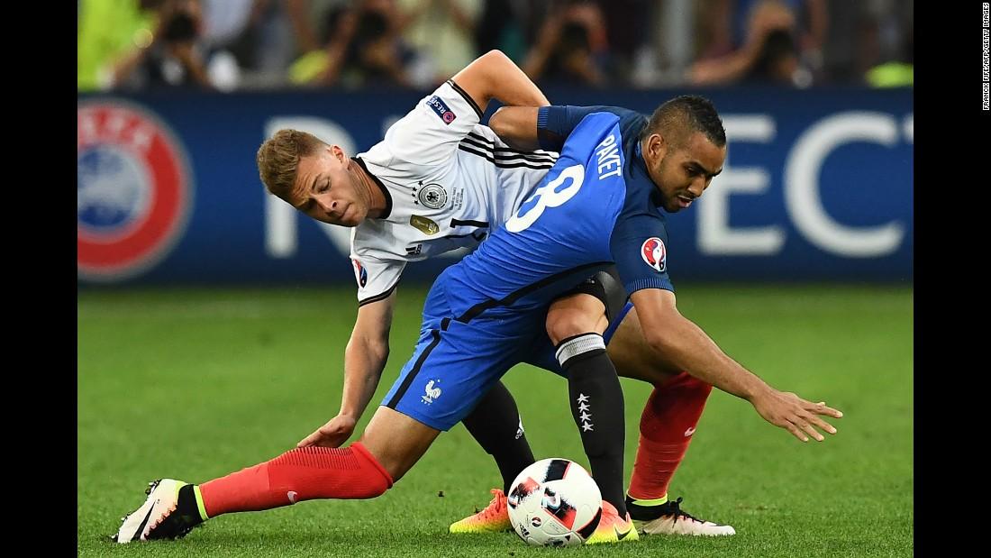 Draxler battles Dimitri Payet for possession.