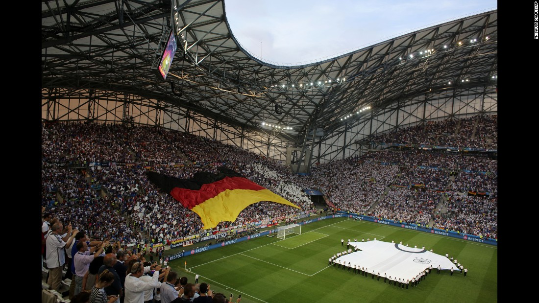 Germany fans wave a large flag in the Velodrome stadium before the match in Marseille, France.