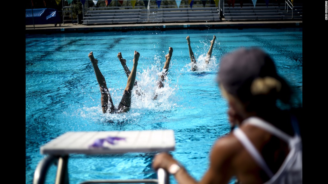 Synchronized swimmers Anita Alvarez and Mariya Koroleva, who will represent the United States in next month's Olympics, train in the pool along with their alternate, Alison Williams.