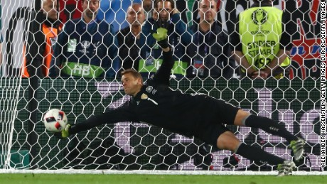 BORDEAUX, FRANCE - JULY 02:  Manuel Neuer of Germany makes a safe during the penalty shootout of the UEFA EURO 2016 quarter final match between Germany and Italy at Stade Matmut Atlantique on July 2, 2016 in Bordeaux, France.  (Photo by Alexander Hassenstein/Getty Images)