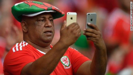 LYON, FRANCE - JULY 06:  A Wales fan uses his phone in the stands before the UEFA EURO 2016 semi final match between Wales and Portugal at Stade des Lumieres on July 6, 2016 in Lyon, France.  (Photo by Mike Hewitt/Getty Images)