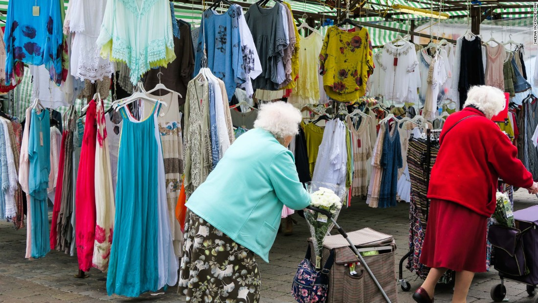 Eldery shooppers peruse the goods at Romford Market.