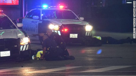 Wounded police officers on the ground in Dallas, July 7th, 2016.