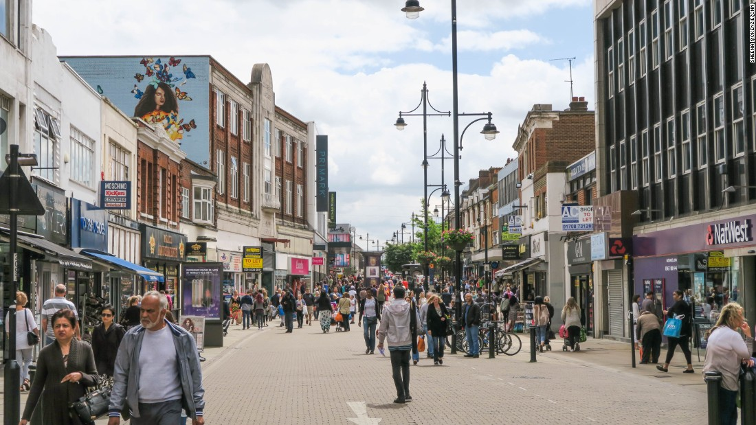 Saturday morning shoppers stream down Romford's high street.