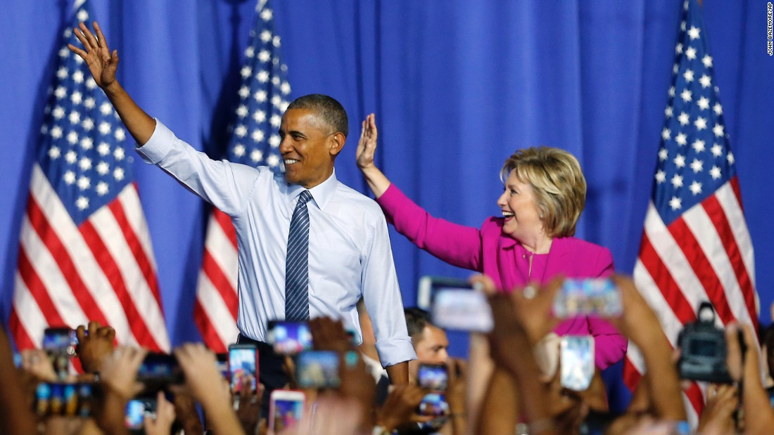 """U.S. President Barack Obama and Democratic presidential candidate Hillary Clinton <a href=""""http://www.cnn.com/2016/07/05/politics/obama-clinton-campaign-charlotte/"""" target=""""_blank"""">attend a campaign rally for her</a> in Charlotte, North Carolina, on Tuesday, July 5. Obama said he became a loyal Clinton convert years ago and that their Democratic primary fight from 2008 is all in the past."""