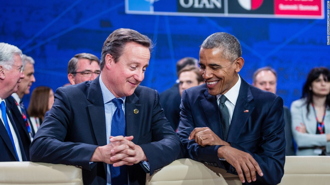 British Prime Minister David Cameron, left, chats with U.S. President Barack Obama during a NATO summit in Warsaw, Poland, on Friday, July 8. Cameron announced his resignation last month after UK voters opted out of the European Union.