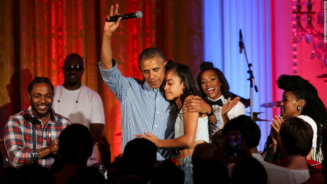 """U.S. President Barack Obama hugs his daughter Malia at the White House Fourth of July party. She was celebrating her 18th birthday during the party, which included musicians Janelle Monae and Kendrick Lamar. <a href=""""http://www.cnn.com/2012/09/05/politics/gallery/sasha-and-malia-2008-present/index.html"""" target=""""_blank"""">See more pictures of Malia and Sasha Obama since their father was elected President in 2008</a>"""