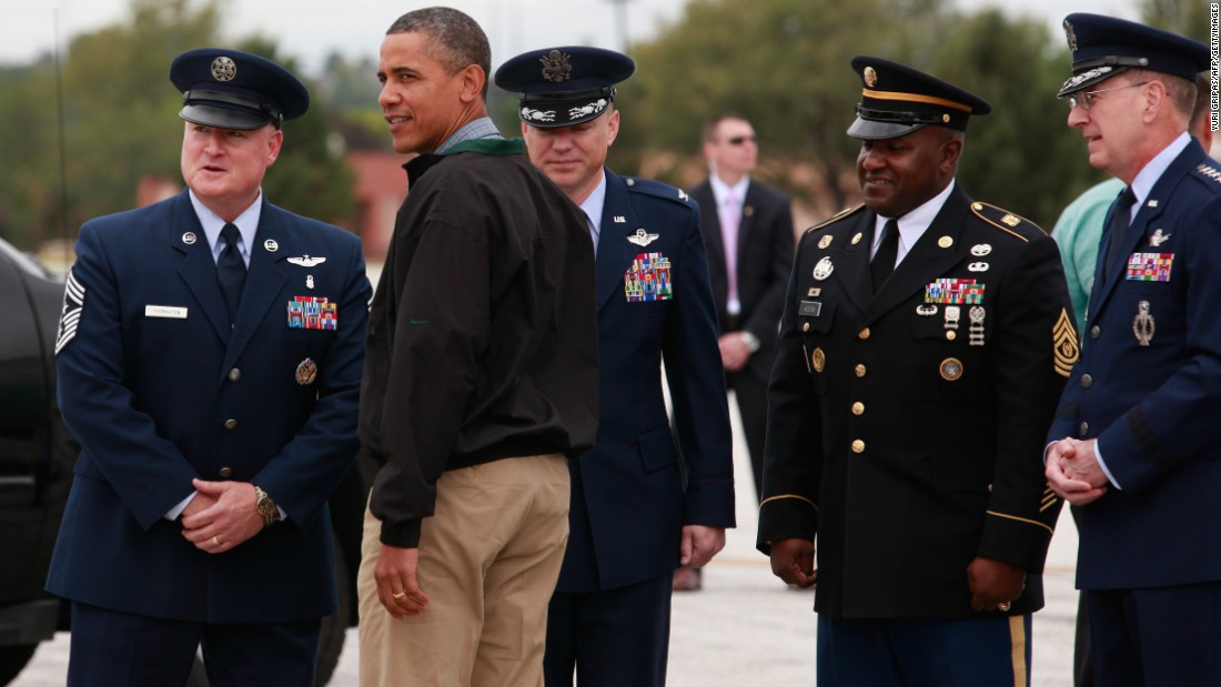 U.S. President Barack Obama is greeted by a military personnel as he arrives at at Offutt Air Force Base in Omaha, Nebraska, on August 13, 2012.