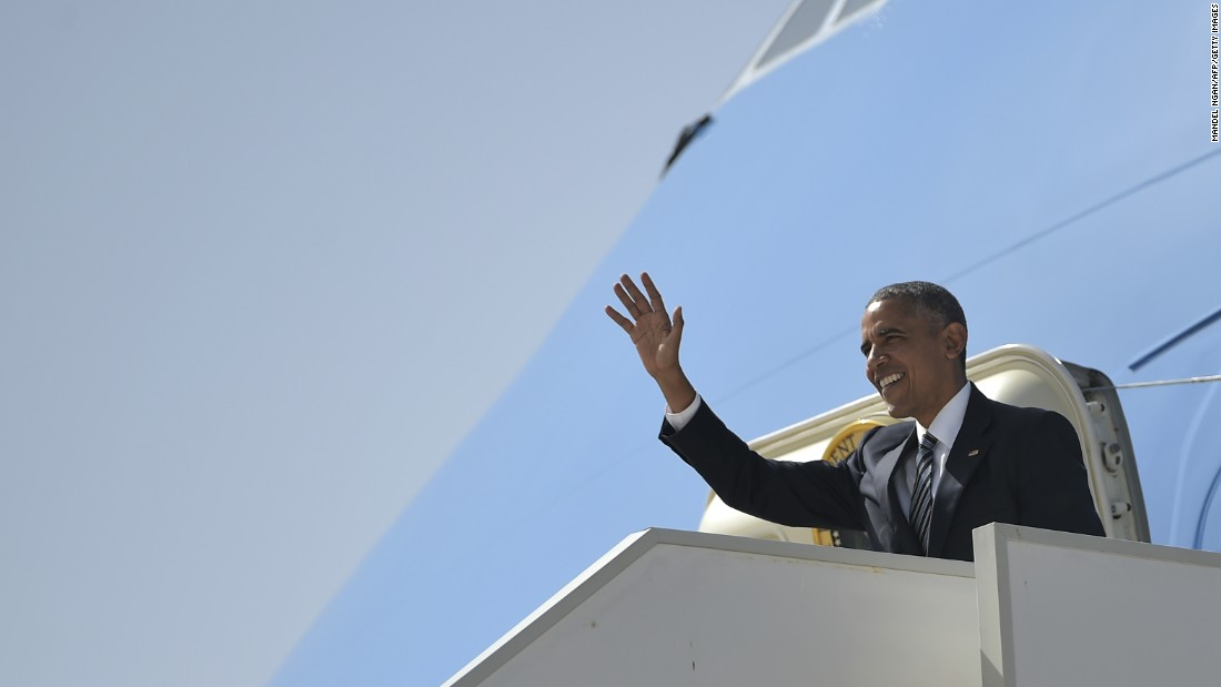 Obama waves as he arrives at Naval Station Rota on July 10.