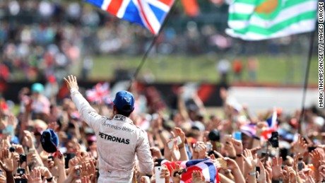 Lewis Hamilton receives a heroes welcome after winning the British Grand Prix at Silverstone for the third straight year.