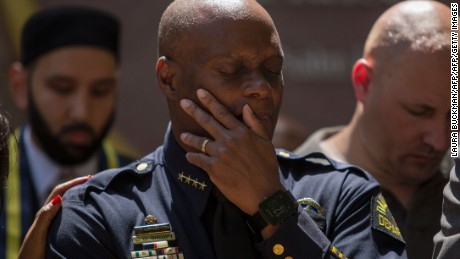 Dallas Police Chief David Brown prays during a vigil July 8