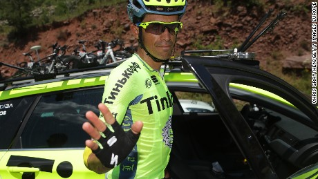 Alberto Contador of Spain climbs into the Tinkoff team car to abandon the Tour de France on the ninth stage.