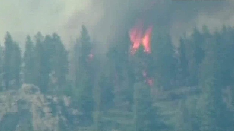 Fast moving wildfires force thousands to flee