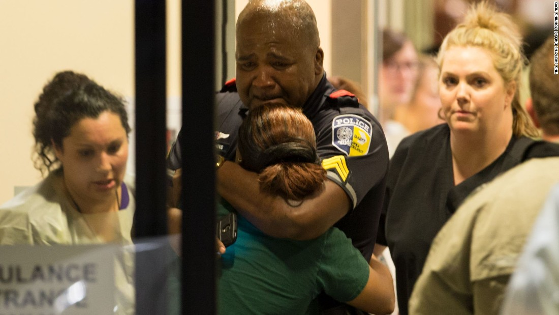 Few other photos captured the sadness and grief of the shooting deaths of five Dallas officers as this photograph of a sobbing DART (Dallas Area Rapid Transit) police officer being comforted at the Baylor University Hospital.