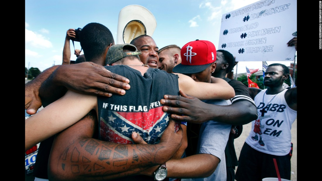 Strength in numbers. All Lives Matter protesters come together for a group hug with Black Lives Matter activists in Dallas. All Lives Matter showed up to the Black Lives Matter