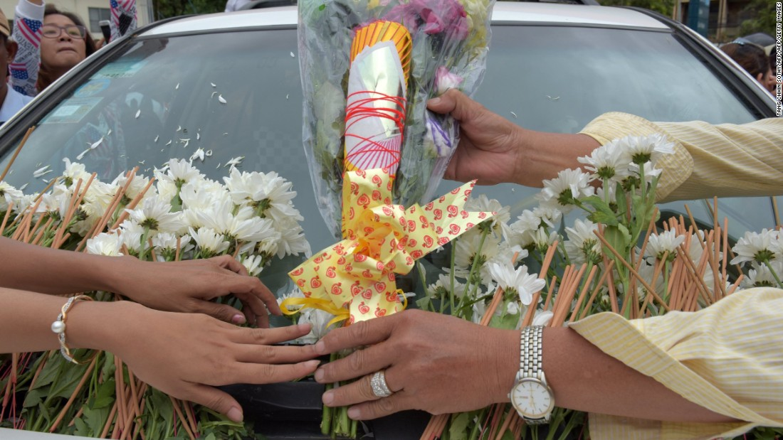 Flowers lay on a car carrying Kem Ley's body.