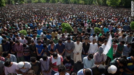 Villagers pray during Saturday's funeral for militant commander Burhan Wani.