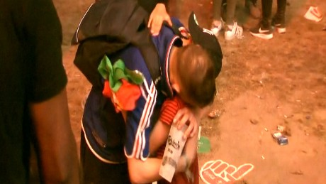 Young Portugal fan consoles French fan