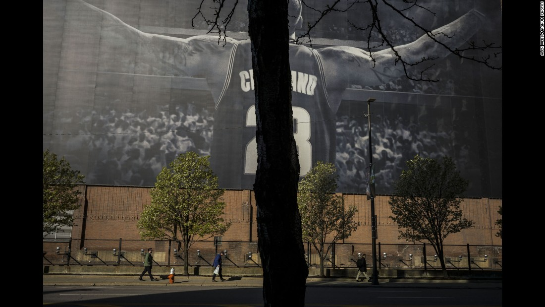 People walk past a LeBron James mural downtown. Cleveland is home to the Cavaliers, who made an improbable comeback in the NBA Finals earlier this year to win their first-ever championship.