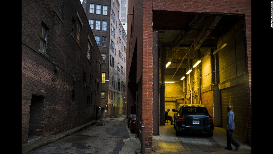 """A car is parked in a garage in a downtown alley. Webb said this is his favorite photograph from his time in the city. """"It's nearing dusk in the photo. There are a number of them like that I like, just before dark or just after dawn, where you are looking in,"""" he said. """"It has a noirish quality -- like a detective film that is shot just at dusk. It was just a moment."""""""