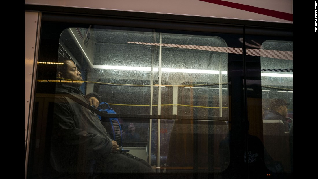 Commuters ride the bus downtown in the early morning.