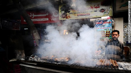 An Egyptian vender cooks kebabs in downtown Cairo on December 30, 2011.