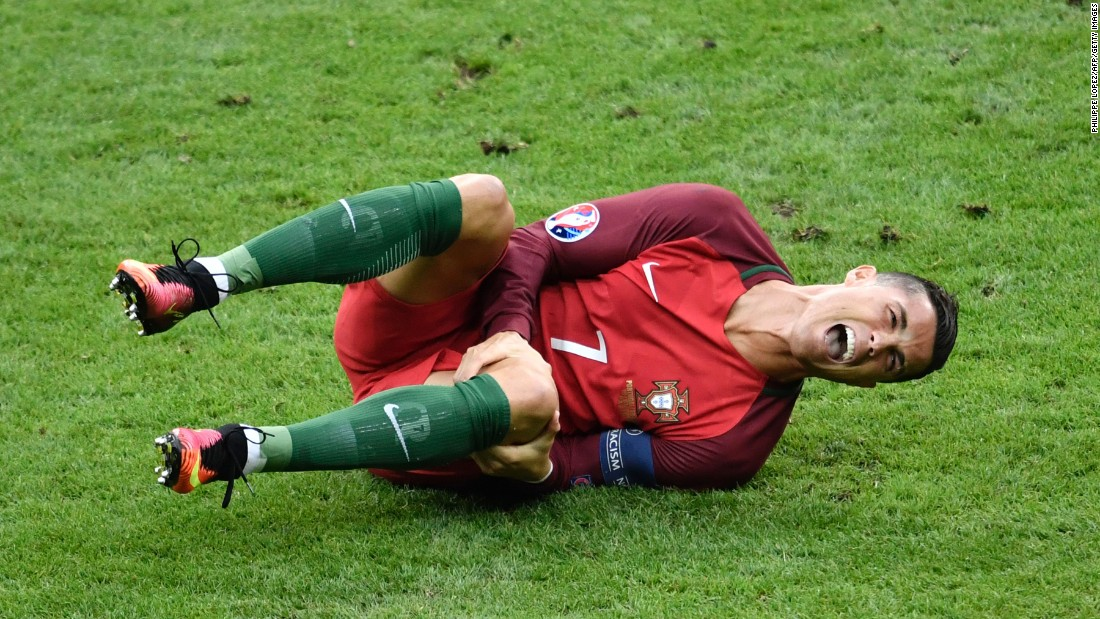 """Cristiano Ronaldo reacts after a tackle by Dimitri Payet during the Euro 2016 championship match between Portugal and France at the Stade de France in Paris on Sunday, July 10. <a href=""""http://edition.cnn.com/2016/07/10/football/france-portugal-euro-2016-final/index.html"""" target=""""_blank"""">Portugal defeated France</a> 1-0, despite Ronaldo being forced to leave the game with a knee injury."""